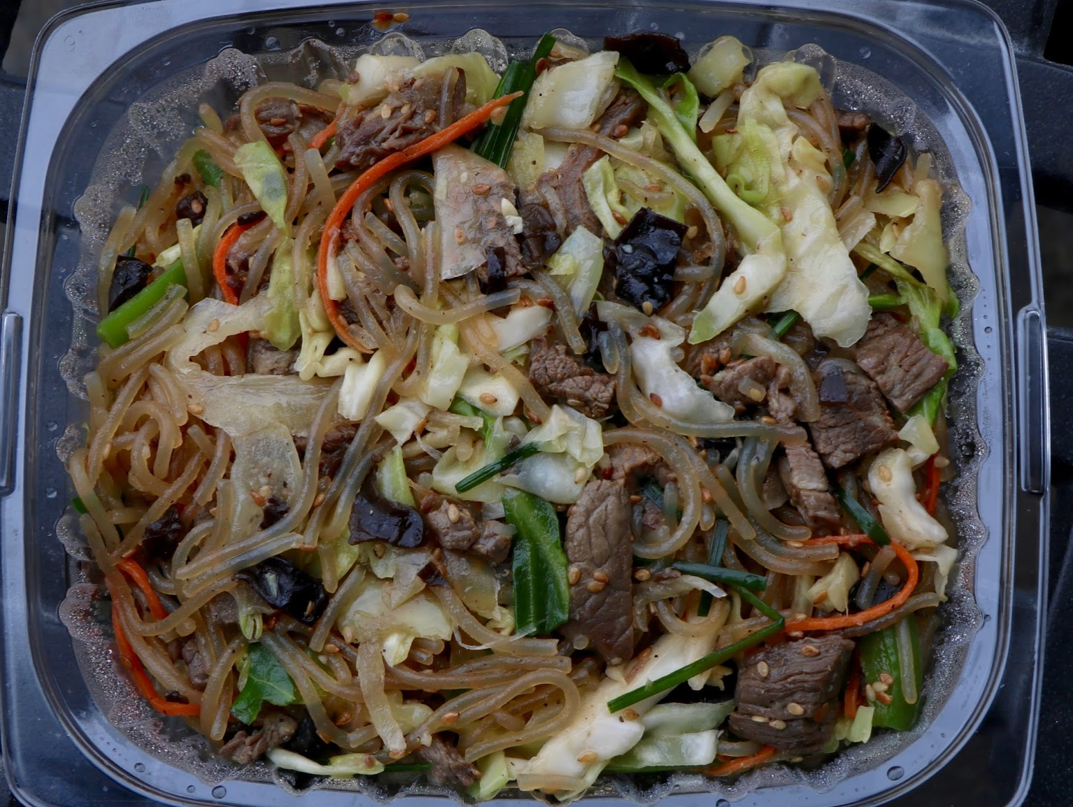 Japchae is a dish composed of cellophane noodles with a soy sauce and sesame oil sauce. Credit: Abigail Massar / The Foothill Dragon Press