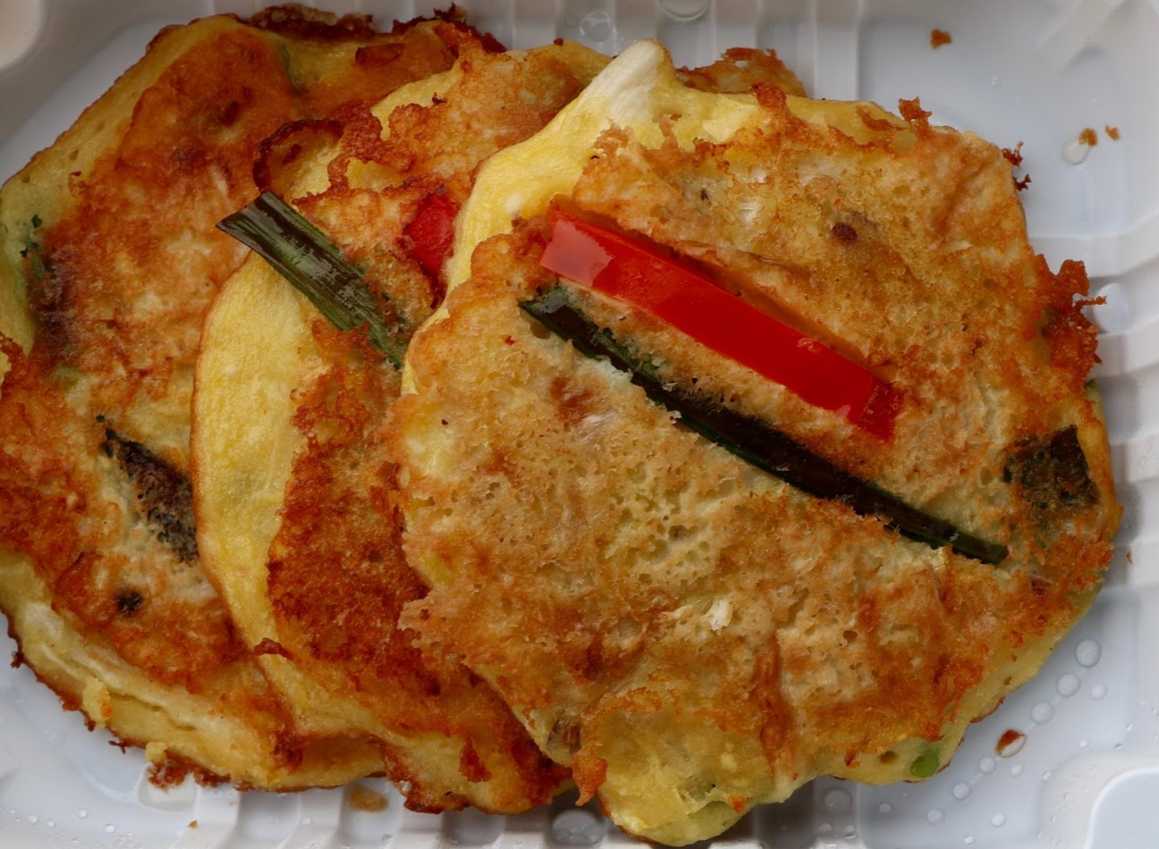 Bindaetteok is a pan fired mung bean pancake. Credit: Abigail Massar / The Foothill Dragon Press
