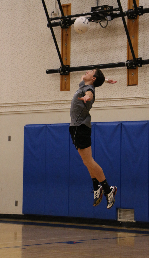 Dylan More '18 takes a float serve. Credit: Jason Messner / The Foothill Dragon Press