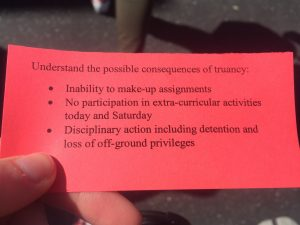 A picture of the red slip that was being handed out to students. Credit: Jocelyn Brossia / The Foothill Dragon Press