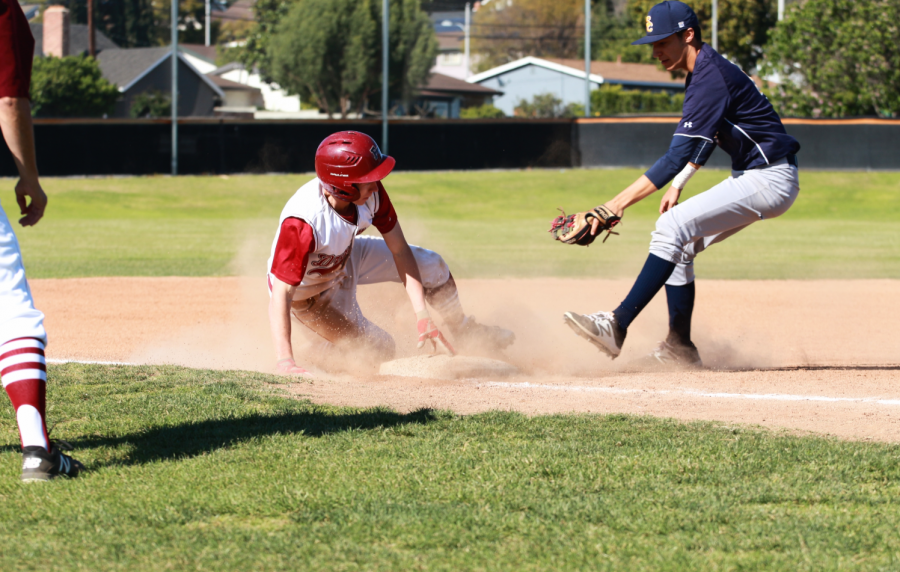 Gage+Corsi+%2719+slides+into+third+base%2C+dodging+a+tag.+Credit%3A+Jason+Messner+%2F+The+Foothill+Dragon+Press