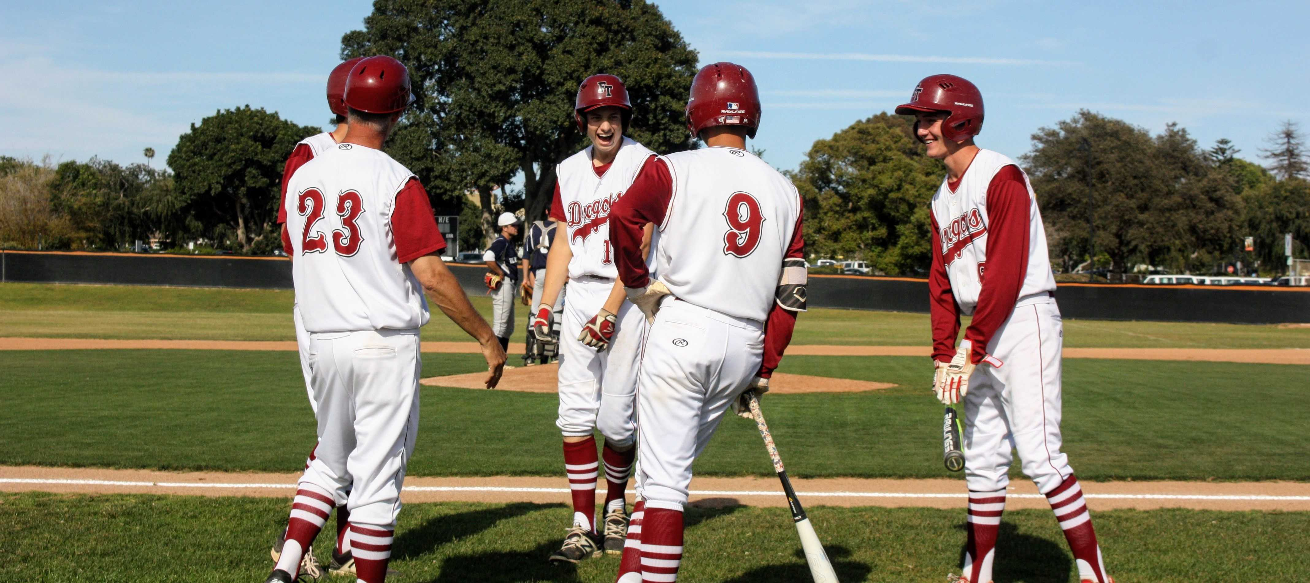 Karl Roth '18 and his teammates celebrate his home run. Credit: Gabrialla Cockerell / The Foothill Dragon Press