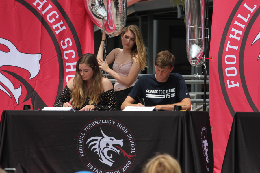 Bridget+McGuire+and+Nathaniel+Russell+%2718+sign+to+their+colleges.+Credit%3A+Jason+Messner+%2F+The+Foothill+Dragon+Press