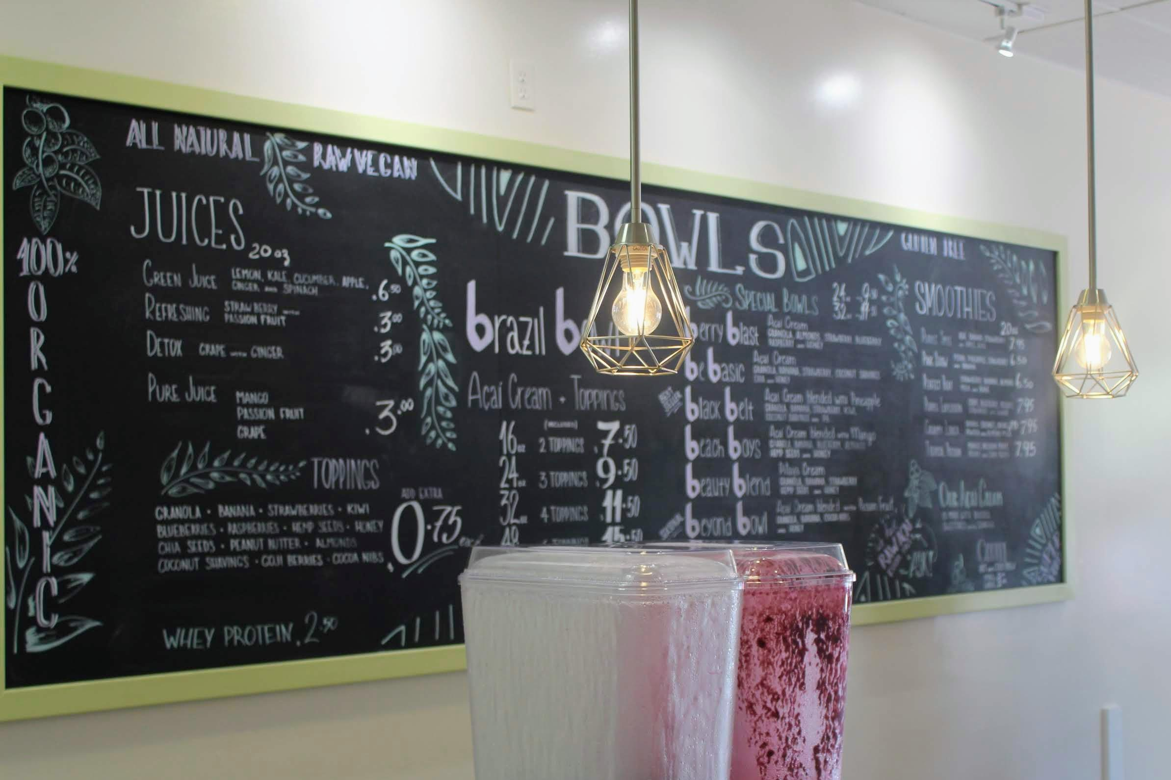The chalkboard menu was designed by an artist from San Diego and boasts options beyond just açaí bowls, like smoothies and juices. Credit: Abby Sourwine / The Foothill Dragon Press