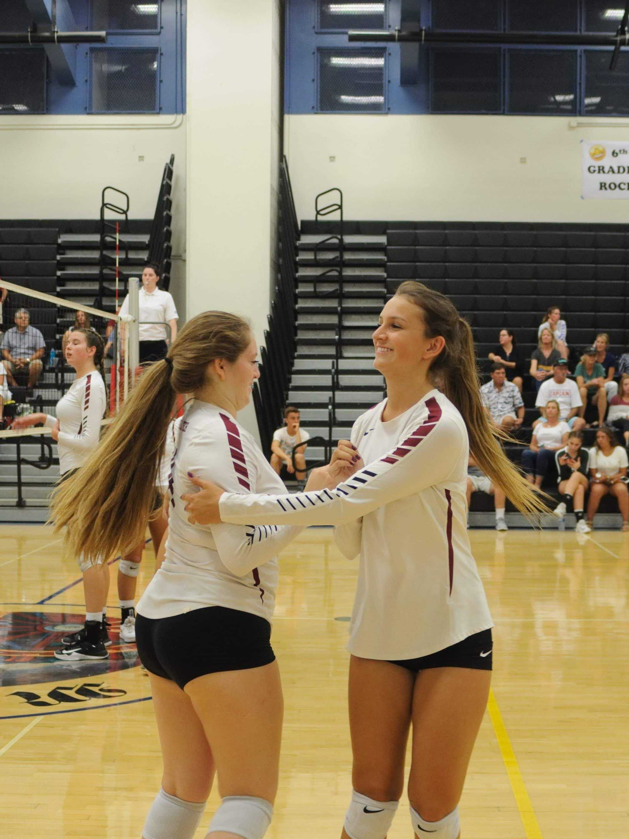 Pearl Esparza '19 congratulating sister Angel Esparza '20 as she subs in. Credit: Muriel Rowley / The Foothill Dragon Press