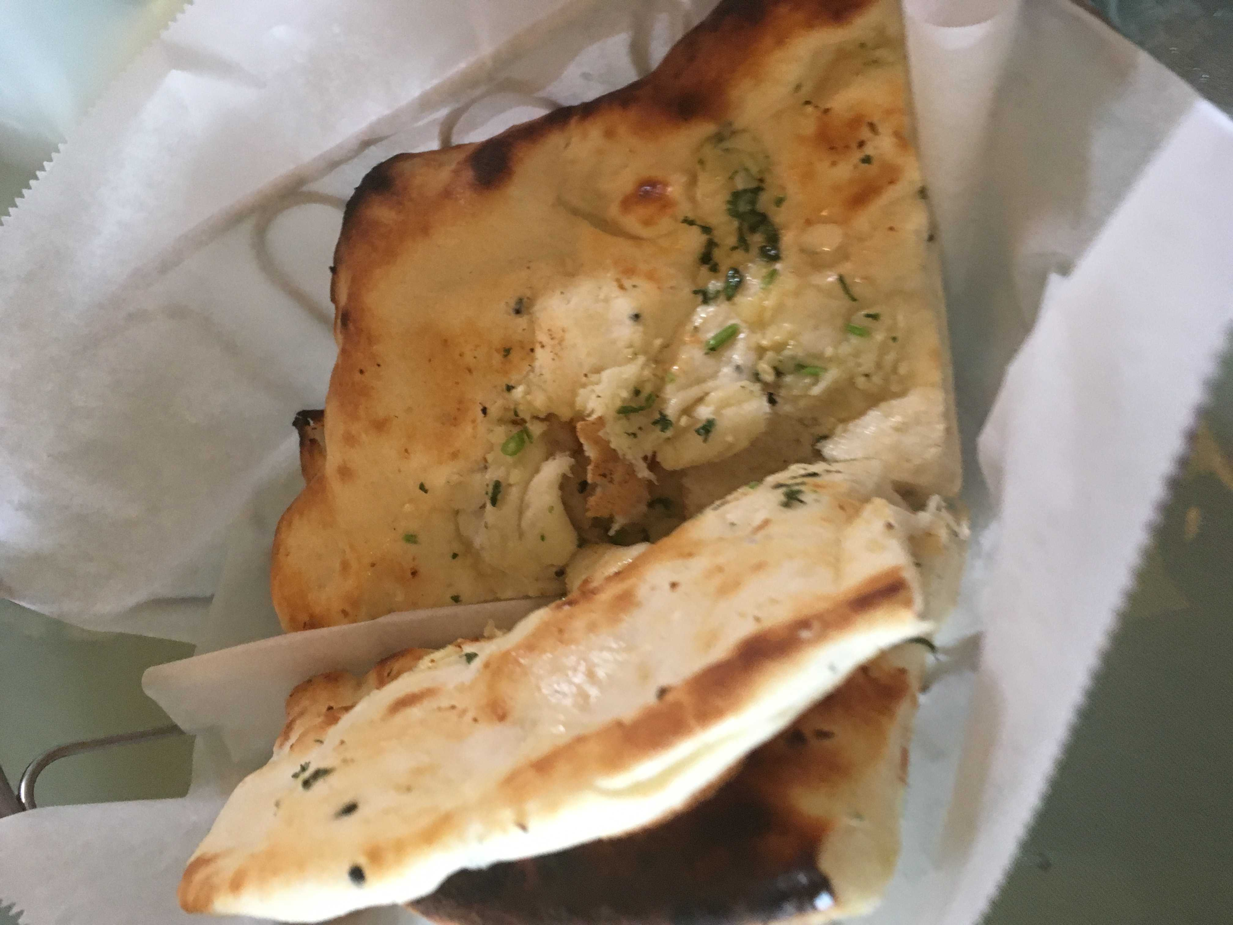 A savory and delicious basket of garlic naan bread from The Taj Cafe. Credit: Elie Bufford / The Foothill Dragon Press