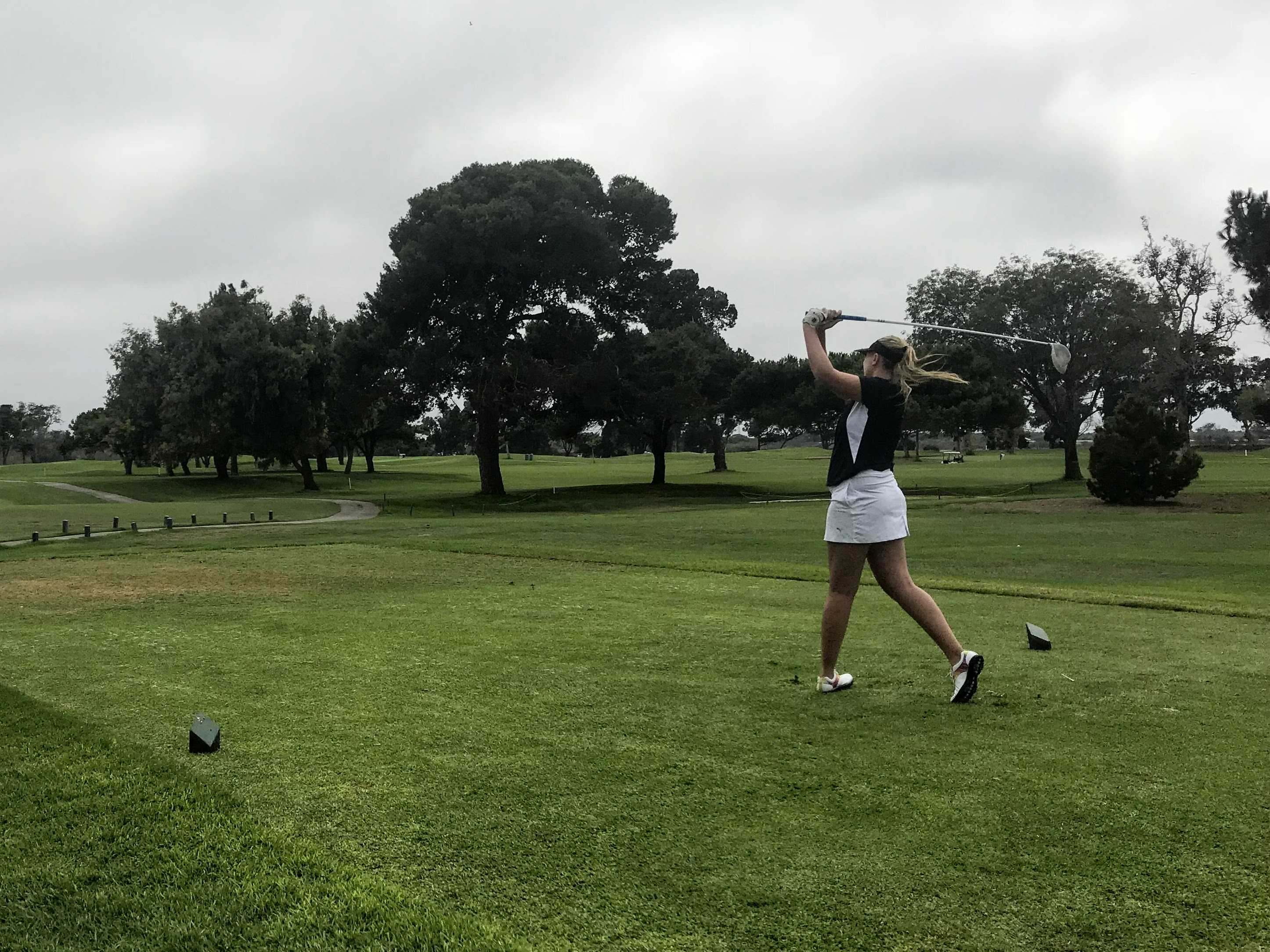 First swing for Paris White '19 on the first hole of the match. Credit: Katie Denger / The Foothill Dragon Press