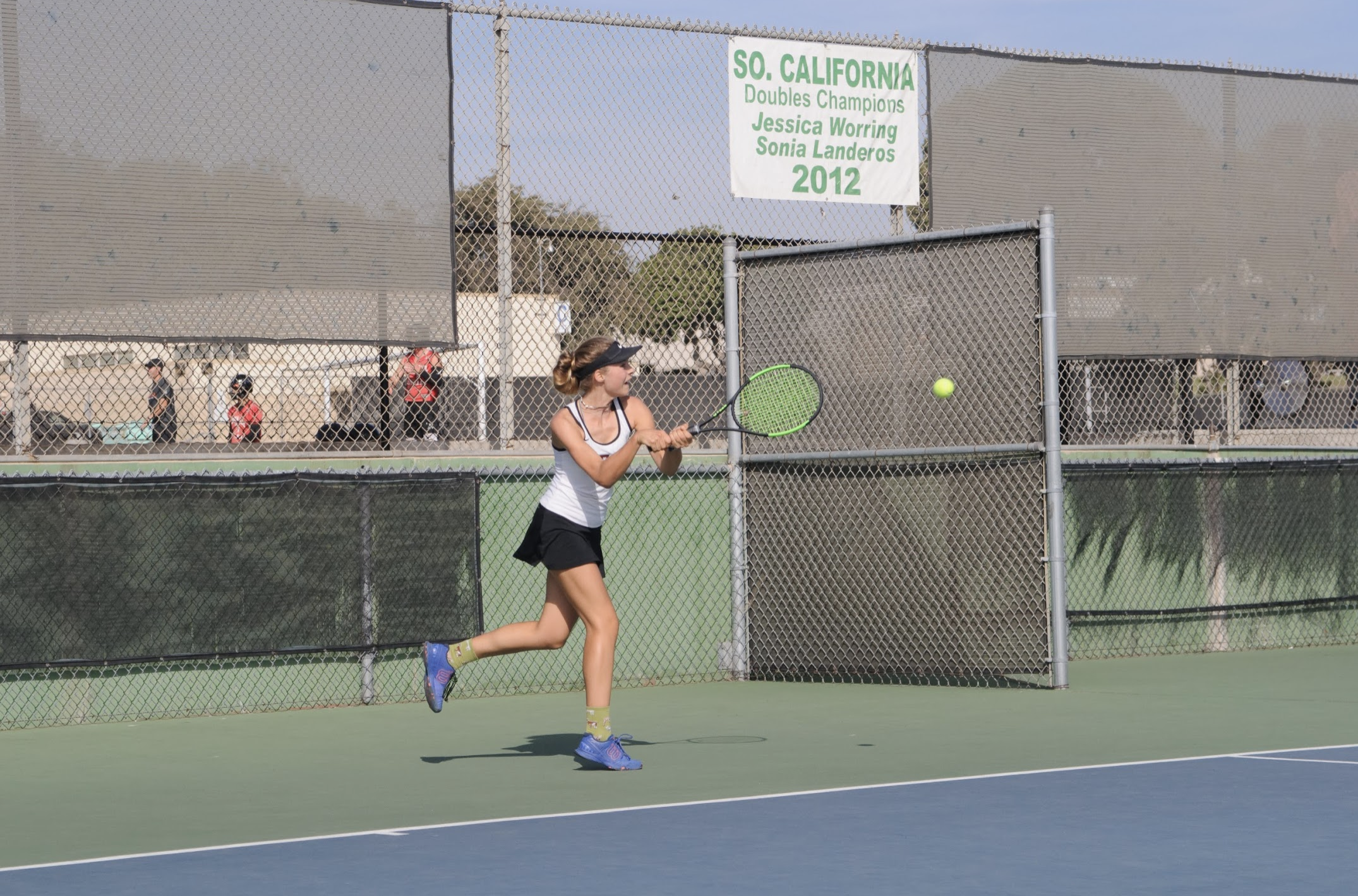 Noelle Hayward '21 gets a point after hitting a firm ball towards her opponent. Credit: Muriel Rowley / The Foothill Dragon Press