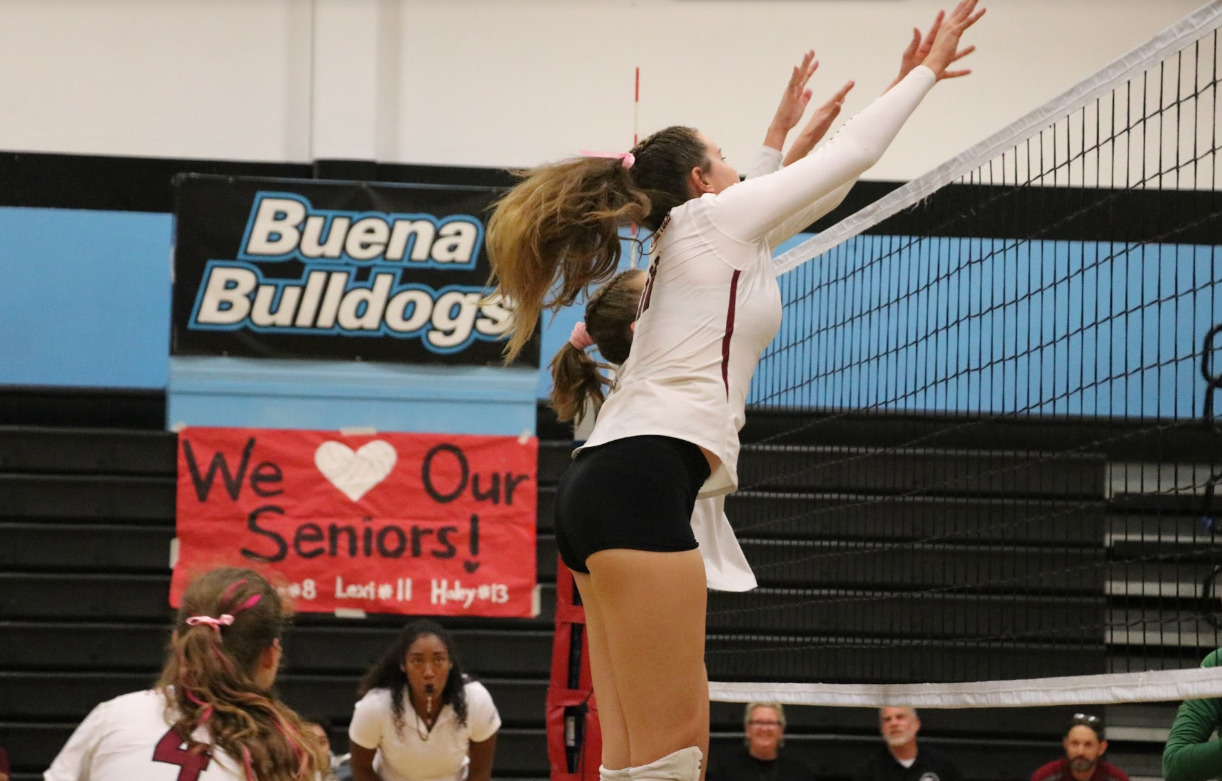 Lexi Malone '19 in action to block the opposing team. Credit: Olivia Sanford / The Foothill Dragon Press