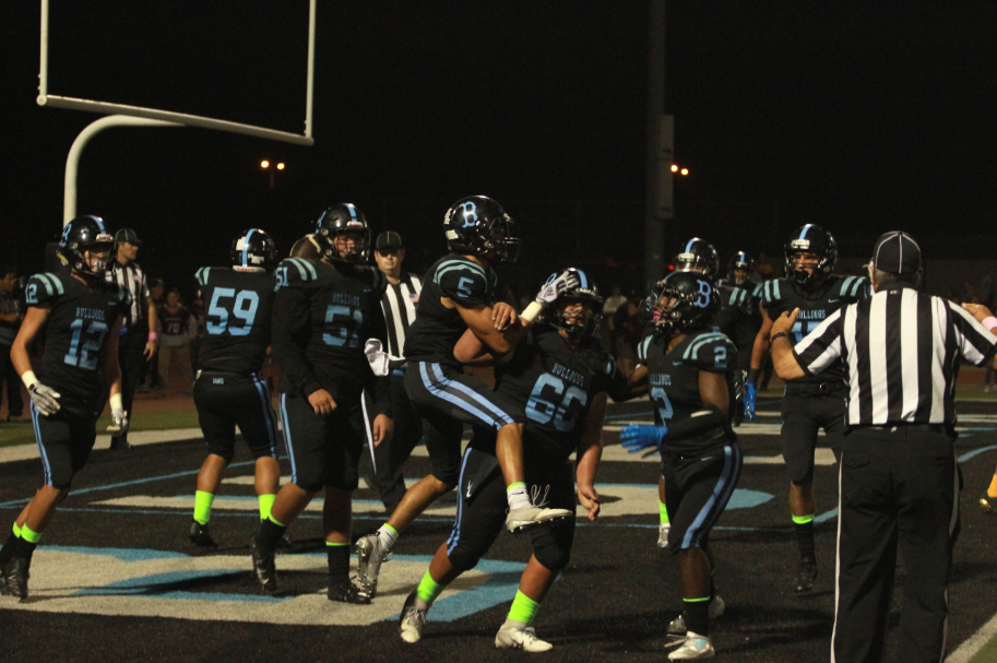 The Bulldogs celebrate after scoring their first touchdown of the game. Credit: Jason Messner / The Foothill Dragon Press
