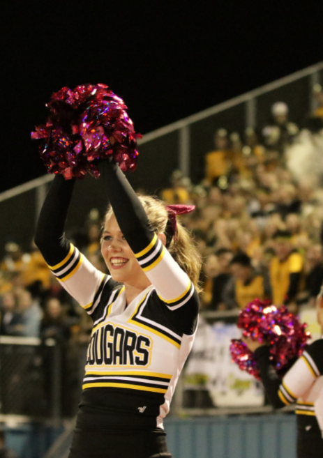 A Cougar cheerleader rallies for her team. Credit: Olivia Sanford / The Foothill Dragon Press