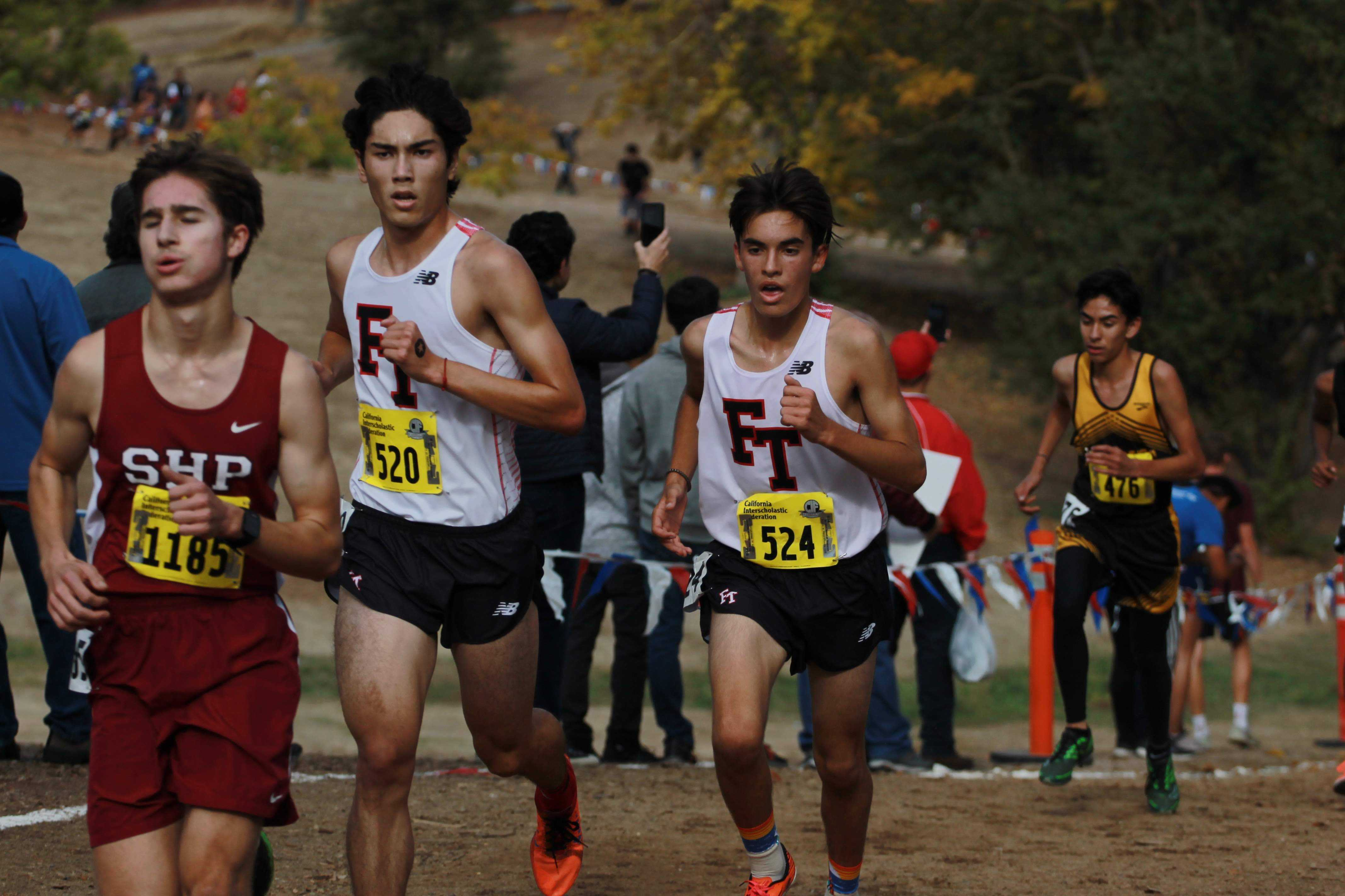 Jason Messner and Joshua Villasenor work up the hill at the two-mile marker. Credit: Jocelyn Brossia / The Foothill Dragon Press