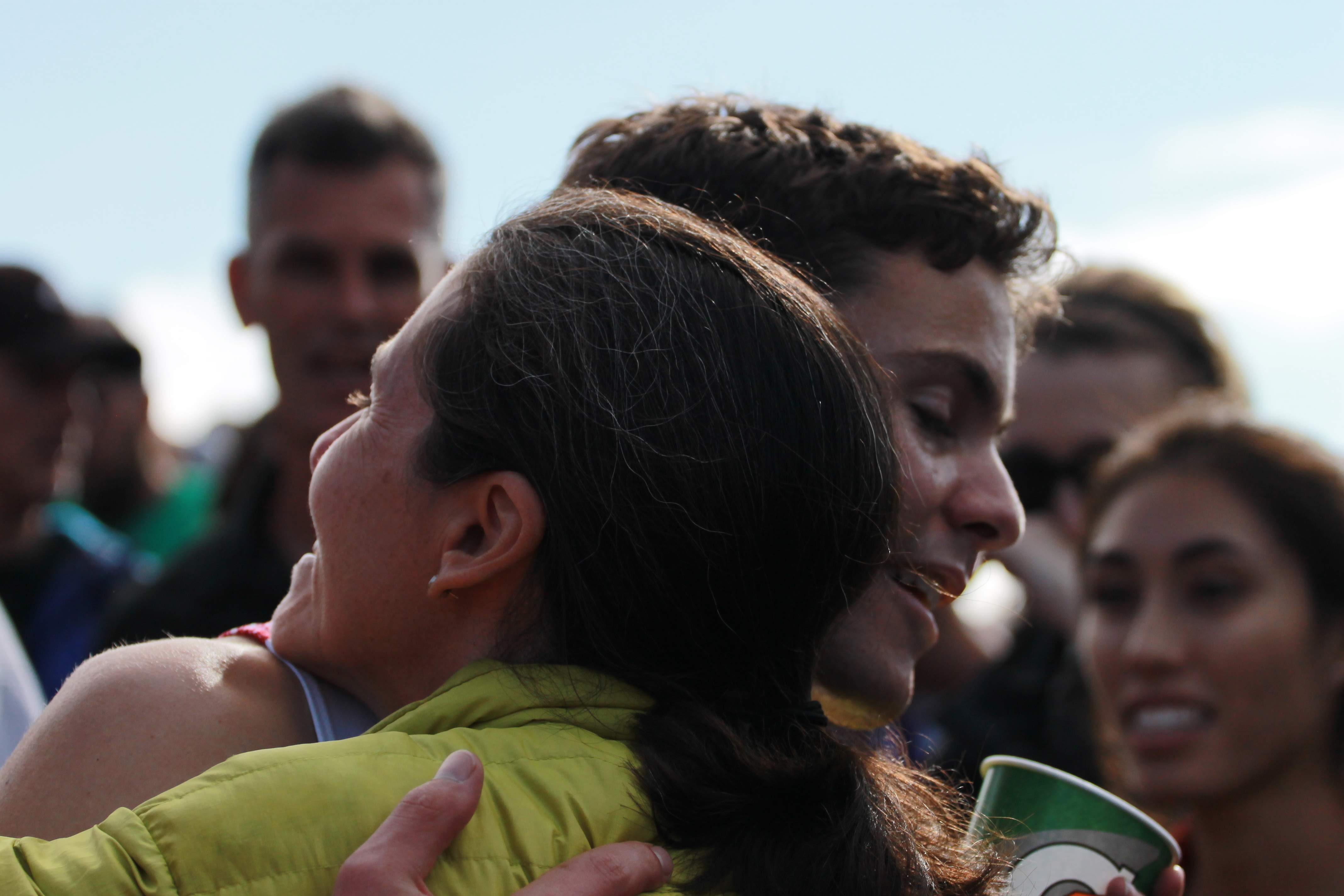 Henry Pick receives a hug from his mom after stepping out of the chute. Credit: Jocelyn Brossia / The Foothill Dragon Press