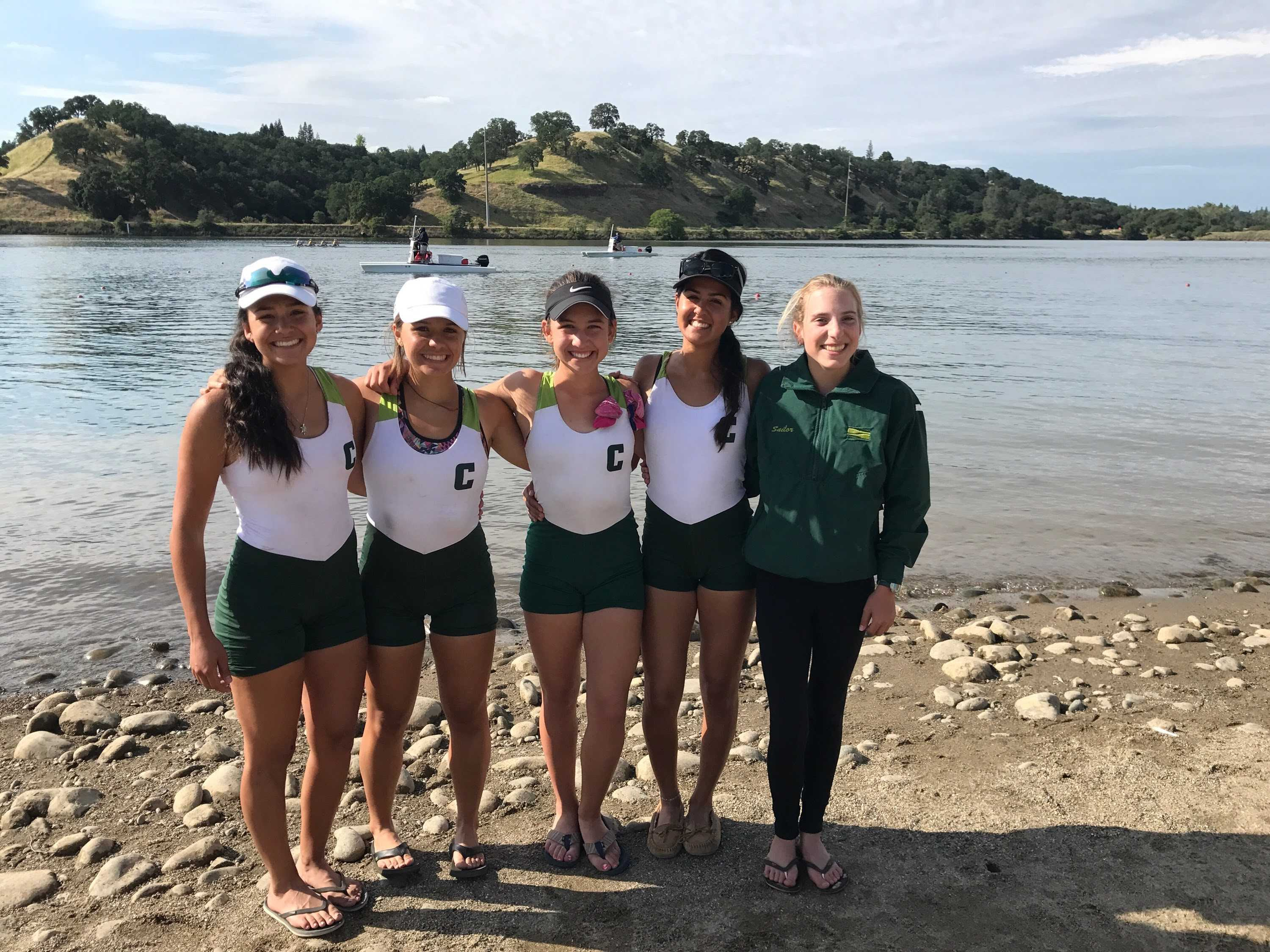 Mia Monsour '21 smiles with her teammates after a race. Credit: Dani Thole