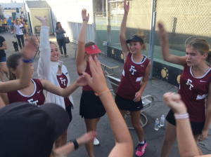 Girls tennis team conquers in historic first match