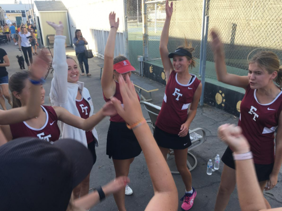 The+girls%27+tennis+team+huddles+at+their+match.+Credit%3A+Abby+Sourwine+%2F+The+Foothill+Dragon+Press+