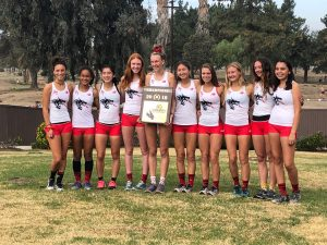 Foothill girls' cross country pose with first-place plaque after winning CIF Finals. Credit: Lauren Kearney (used with permission)