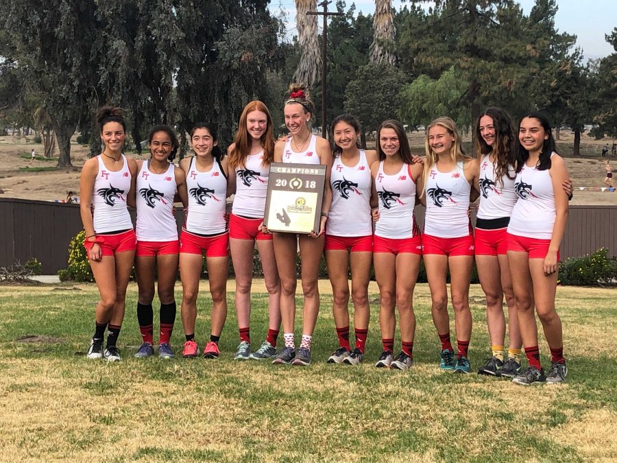 Foothill+girls%E2%80%99+cross+country+pose+with+first-place+plaque+after+winning+CIF+Finals.+Credit%3A+Lauren+Kearney+%28used+with+permission%29