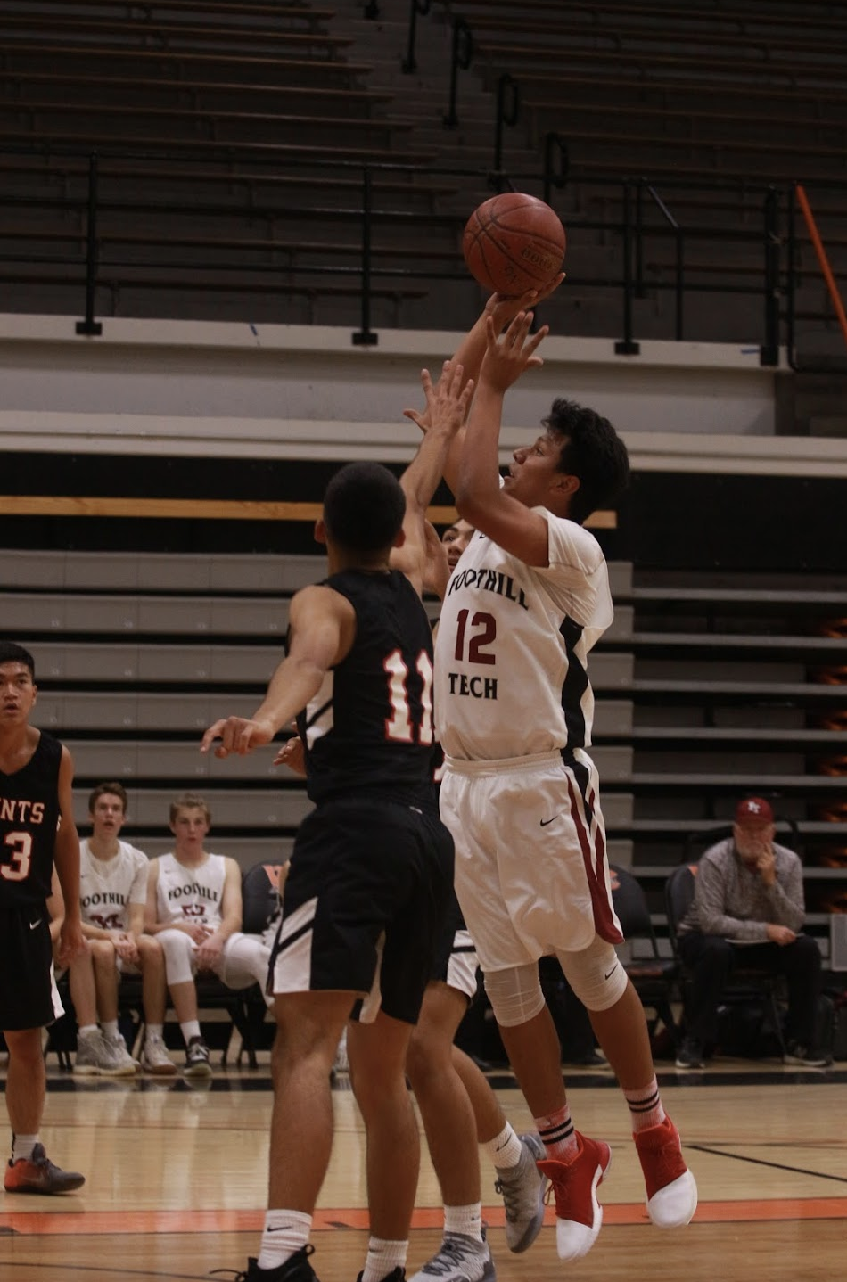 Ty Macias '20 puts up a floater from inside the key. Credit: Jason Messner / The Foothill Dragon Press