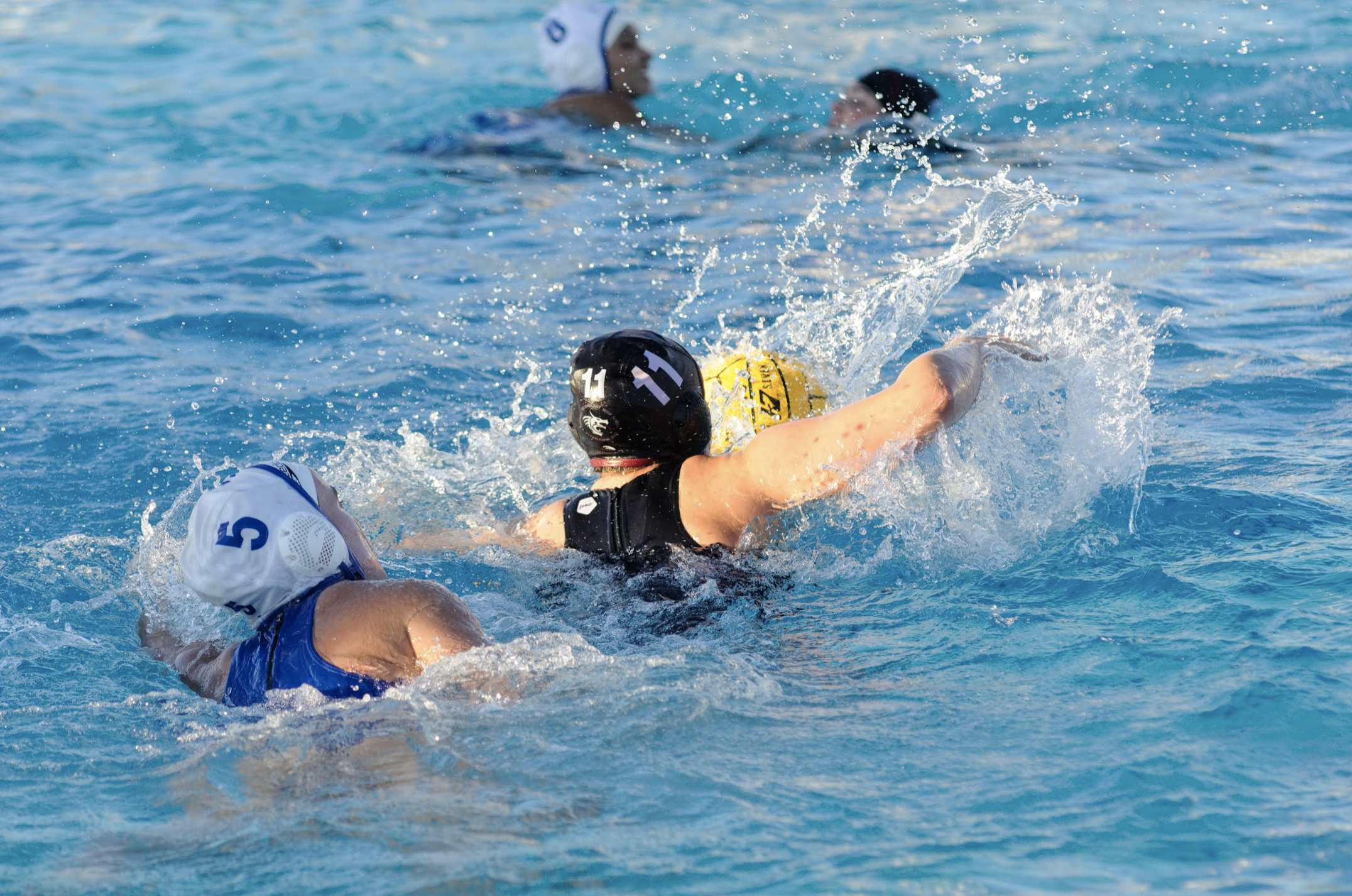 In first home game, girls' water polo cruises to 16-2 win against Cate