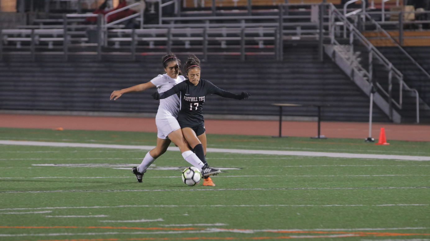 Alyssa Elias '19 battling for the ball. Credit: Olivia Sanford / The Foothill Dragon Press