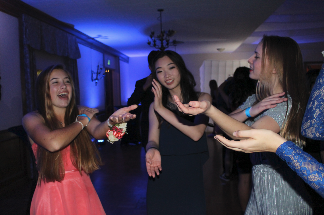 Hannah Hart '20, Michelle Kim '20 and Magnolia Fife '20 do the Macarena to a song which is most definitely not La Macarena. Credit: Maya Avelar / The Foothill Dragon Press