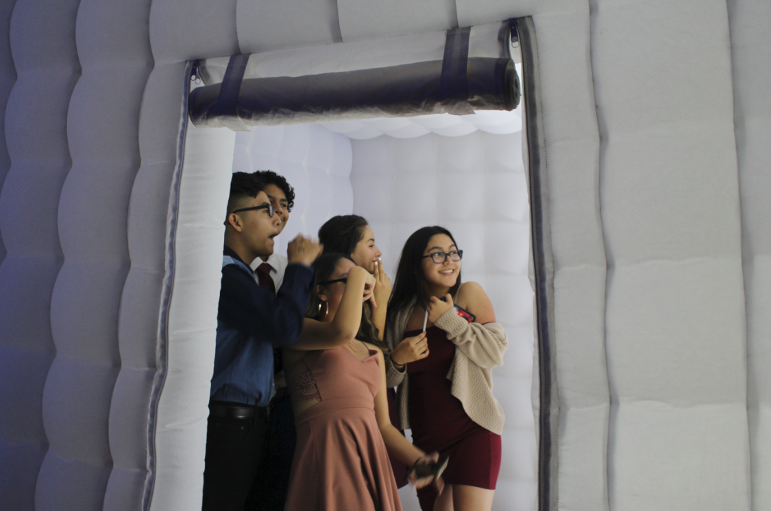 Students pose for a different camera inside of the photo booth. Credit: Maya Avelar / The Foothill Dragon Press