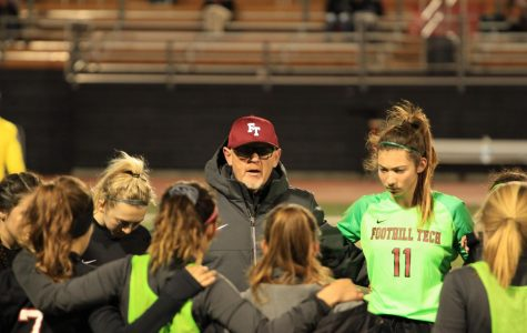 Head coach Jack Craig talks to the girls prior to the game. Credit: Ethan Crouch / The Foothill Dragon Press