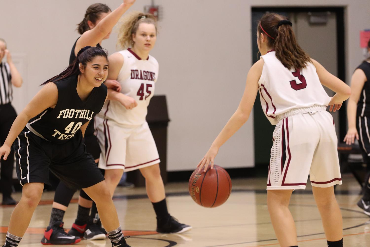 Cydnie Gutierrez '19 guards former teammate Cierra Marienthal '22 with a smile on her face