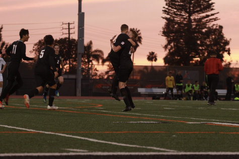 Dragons celebrate after scoring the first goal of the game. Credit: Jason Messner / The Foothill Dragon Press