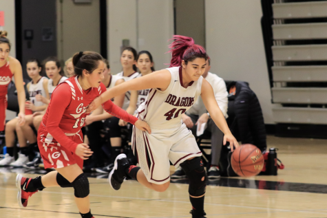 Cydnie Gutierrez blows by Grace Brethren player Kayla Hernandez