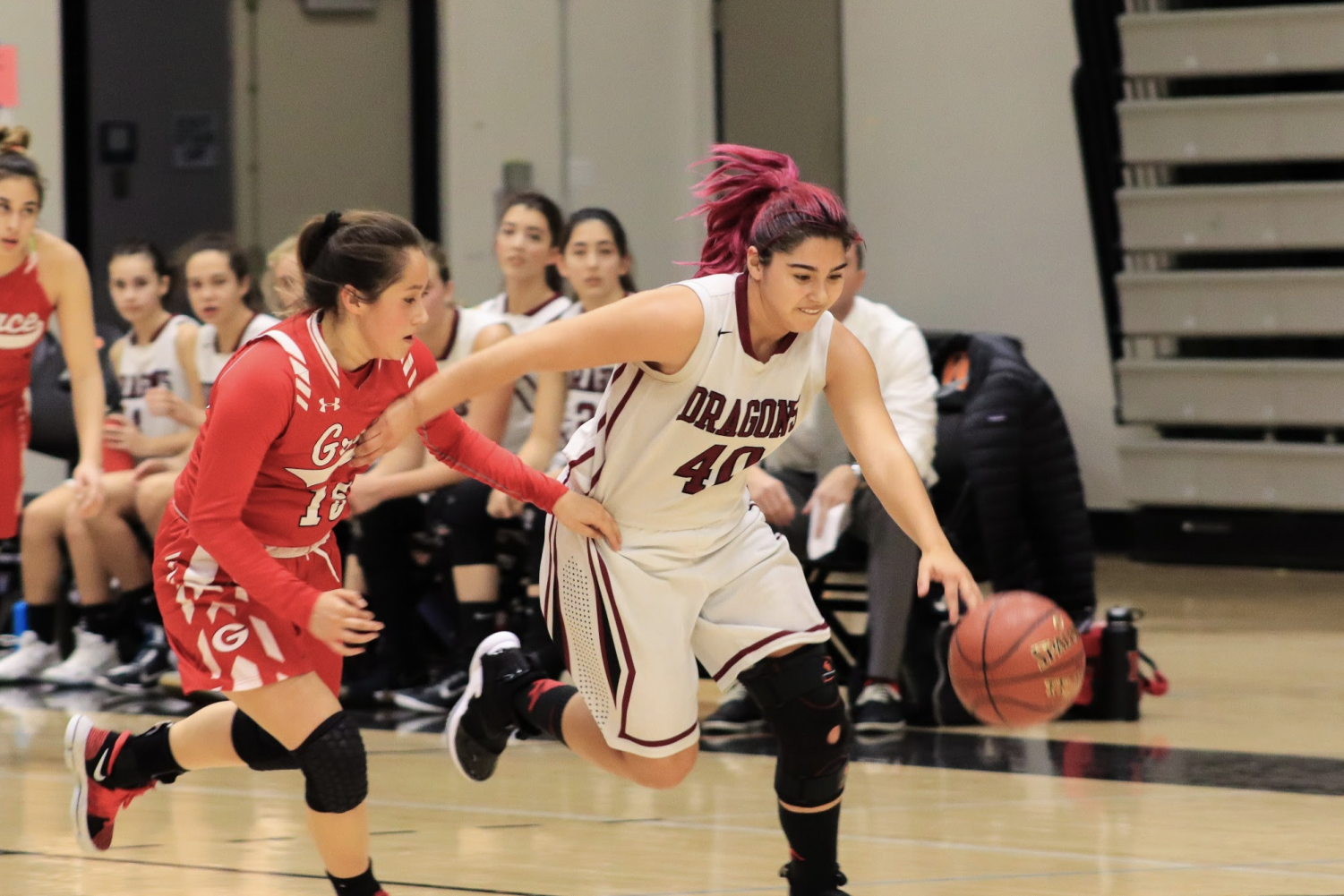 Cydnie Gutierrez blows by Grace Brethren player Kayla Hernandez '19. Credit: Claire Renar / The Foothill Dragon Press