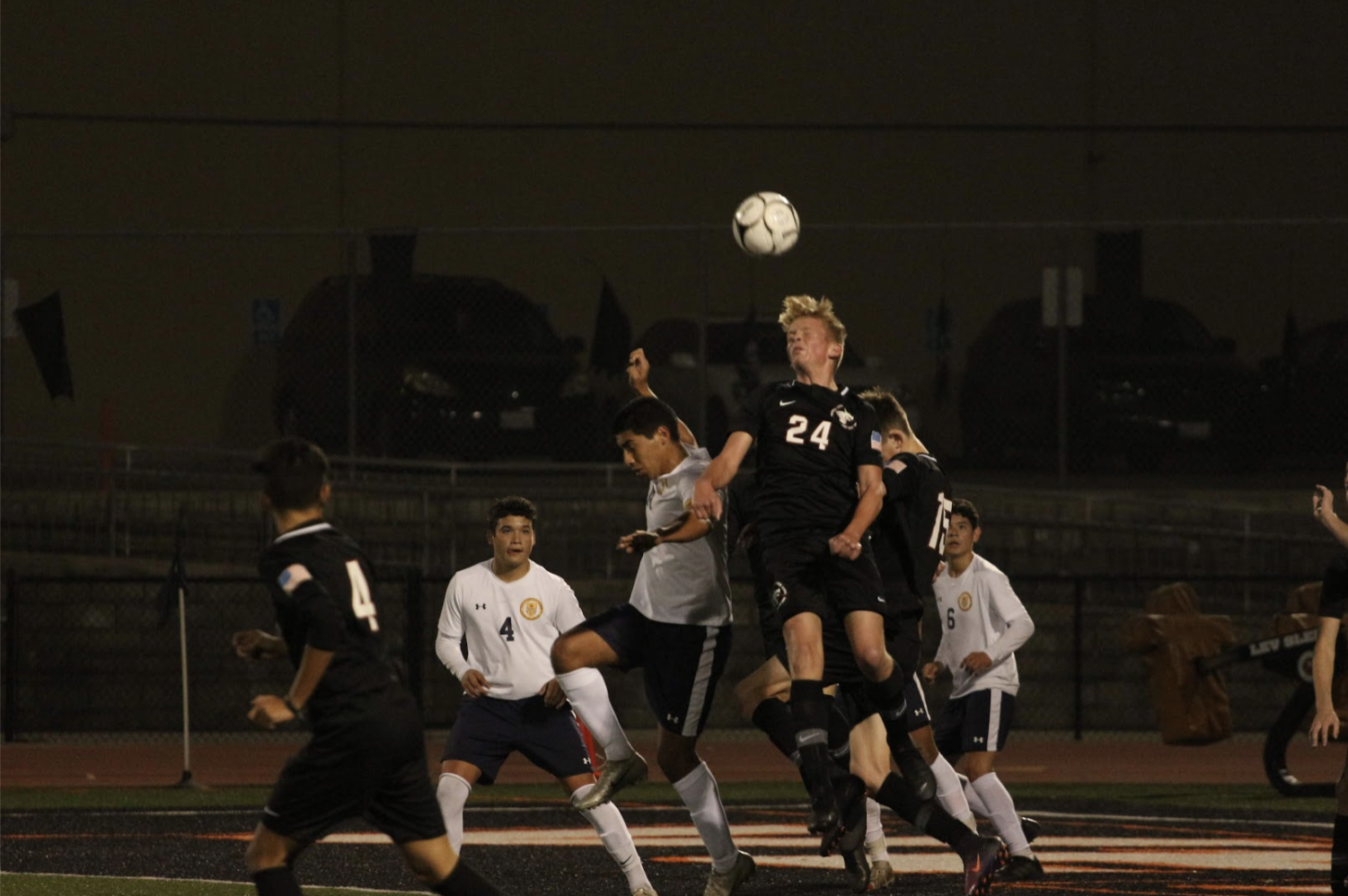 Kyle Grenier '20 jumps into the air to fight for an incoming ball. Credit: Jason Messner / The Foothill Dragon Press