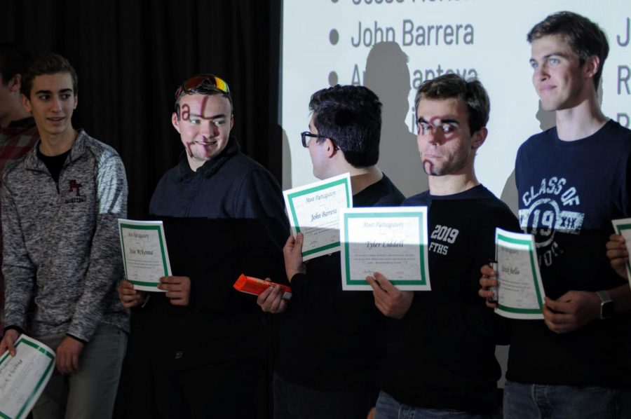 Seniors+Jack+Vielbig%2C+Jesse+McKenna%2C+John+Barrera%2C+Tyler+Liddell%2C+and+Patrick+Bello+stand+on+stage+as+they+accept+their+most+participatory+award.