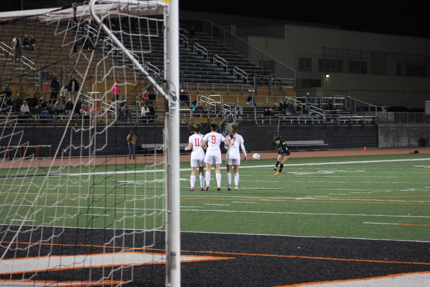In the team's last attempts to score, Alyssa Elias '19 receives a free kick just outside the goal box.