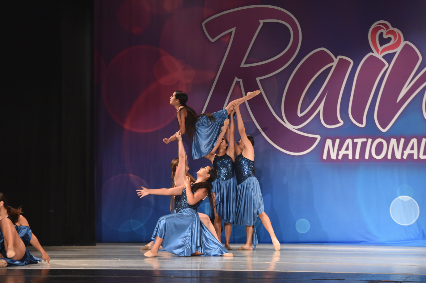 Vanessa Luna '19 soars high above the dance floor at a competition.