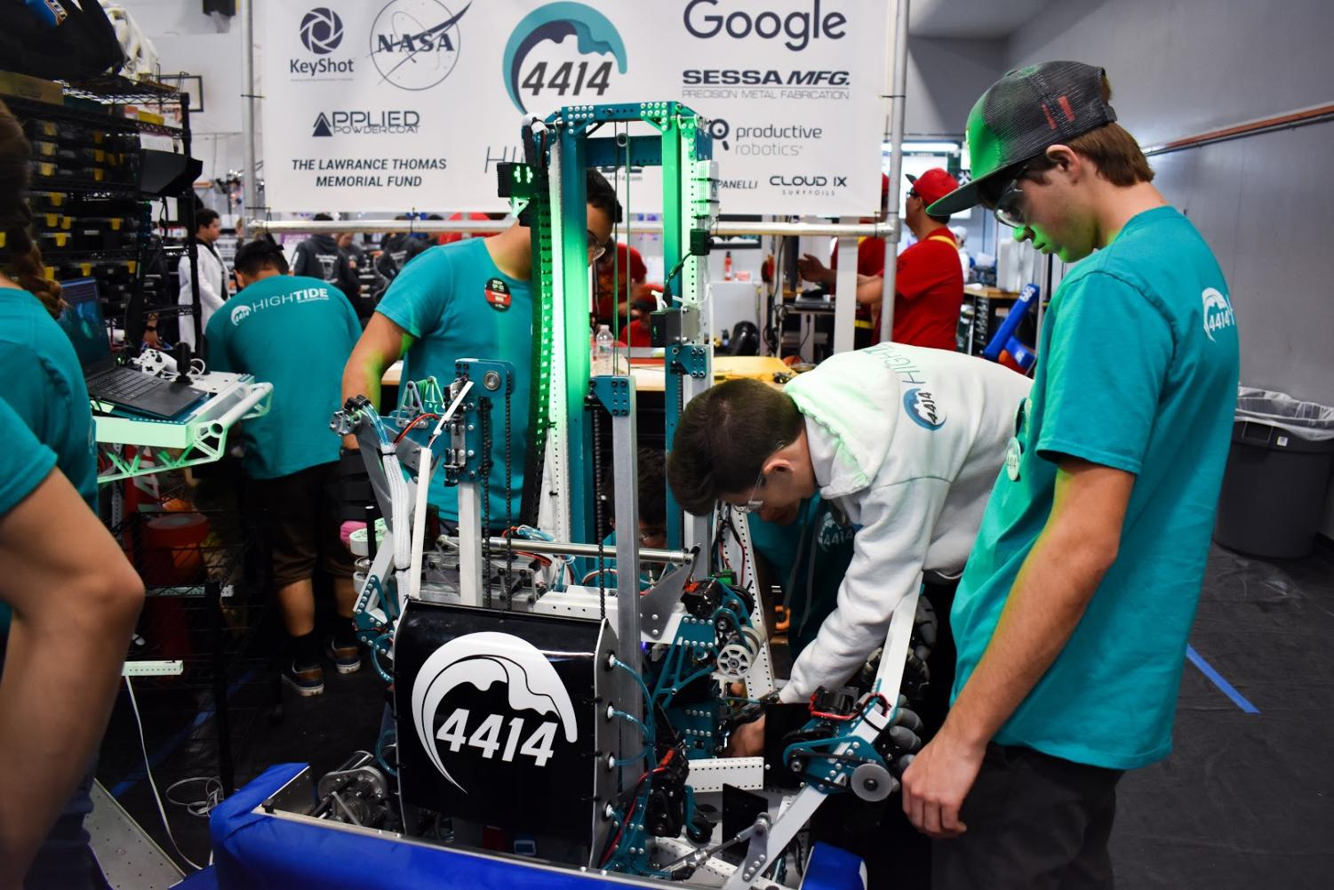 What Team 4414 does is design one robot per season, which they build to meet the FIRST robotics competition objectives,