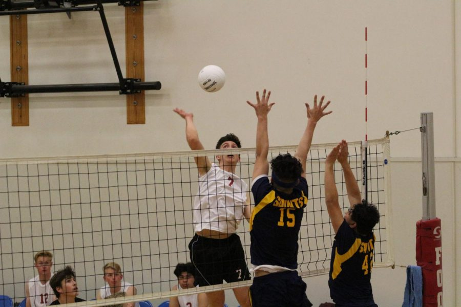 Stefan Fahr 19 leaps into the air to extend his arm and send the ball down to his opponents.