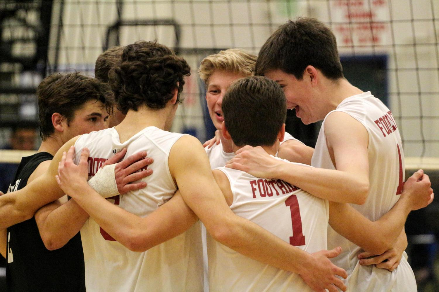 The boys celebrate on the court after scoring a point against Santa Clara.