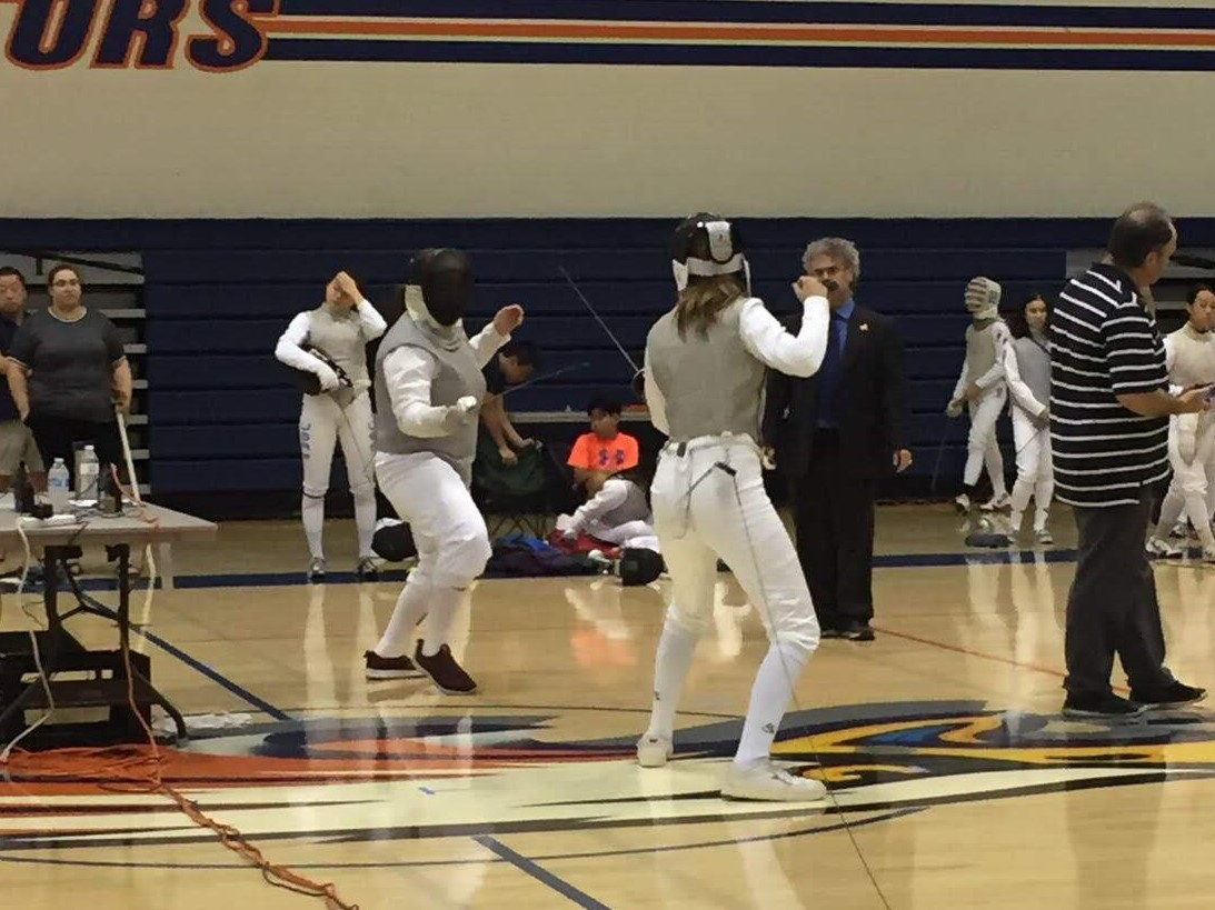 Juliet Ward '21 faces an opponent in a fencing due