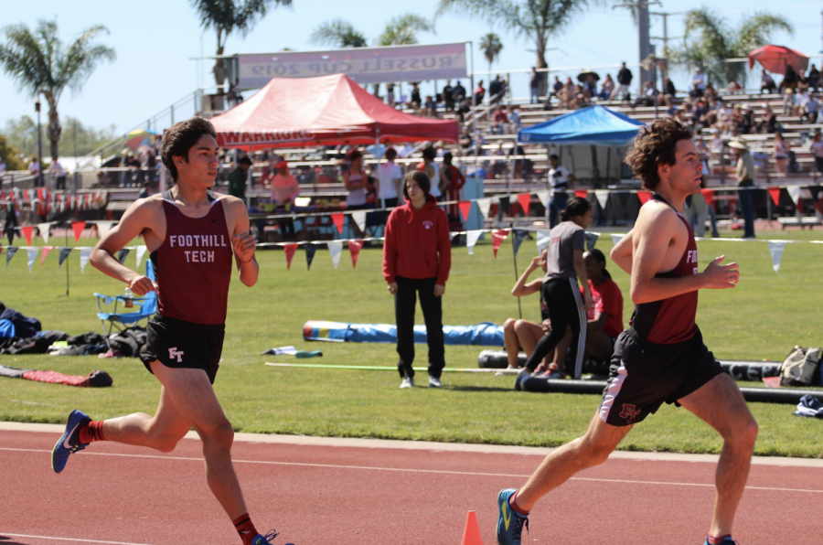Henry Pick '19 and Jason Messner '19 push to the front during the one-mile race.