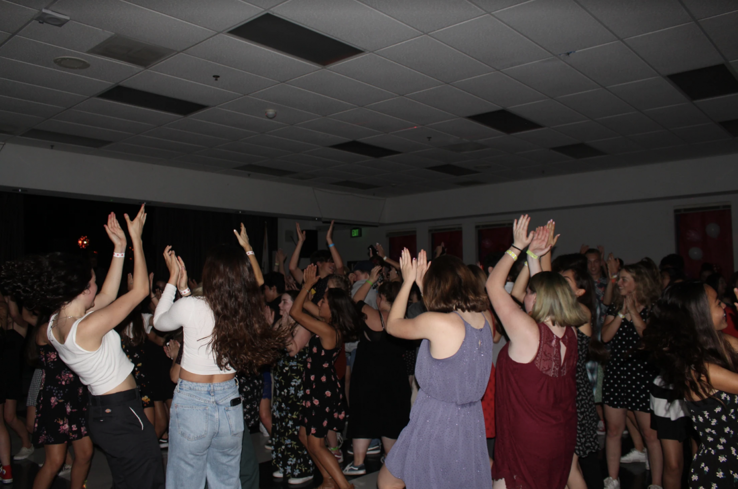 Students clap to the beat of the music at Foothill's Sadie Hawkins dance.