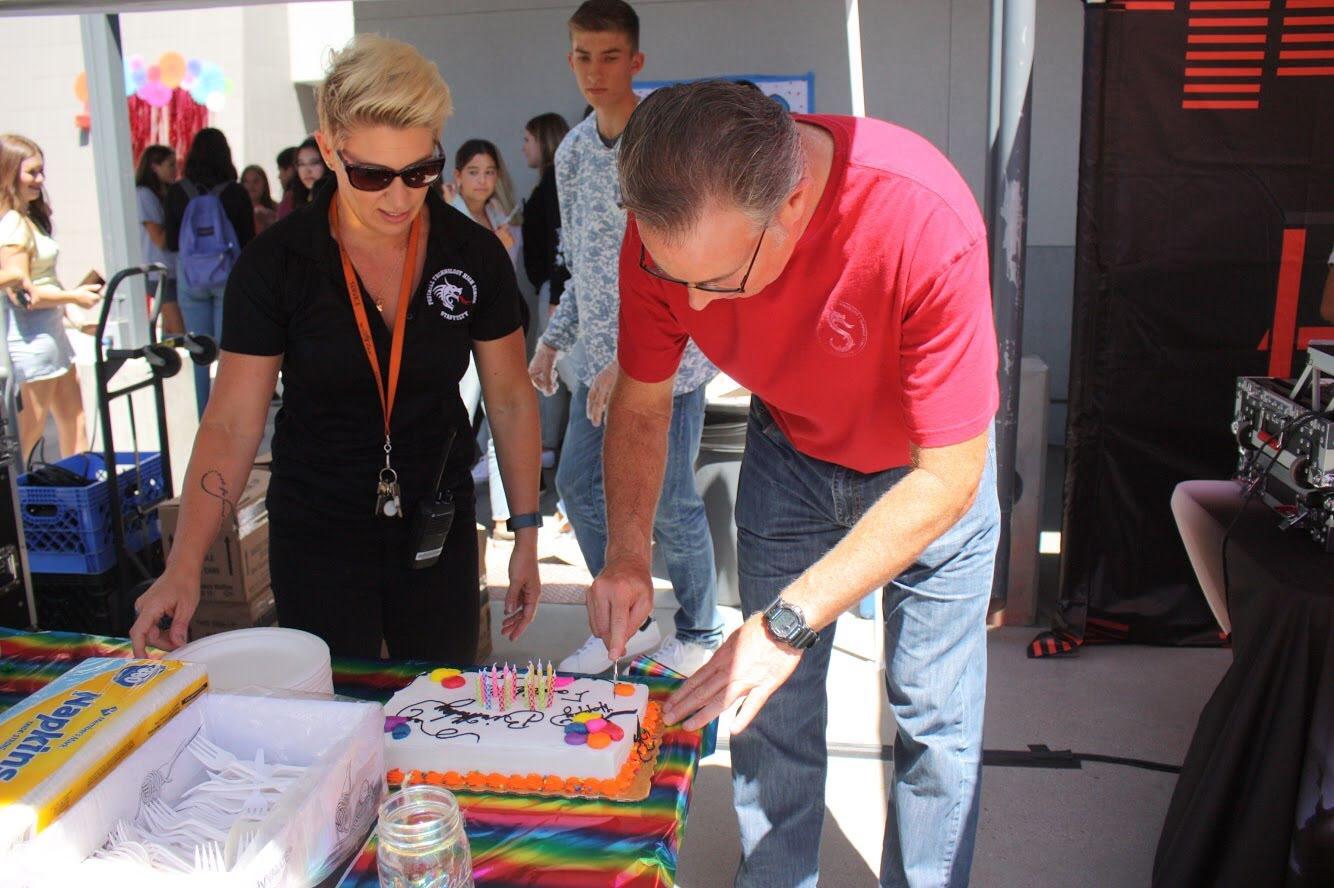 Original+teacher+of+Foothill+Richard+Geib+cuts+into+Foothill+birthday+cake.