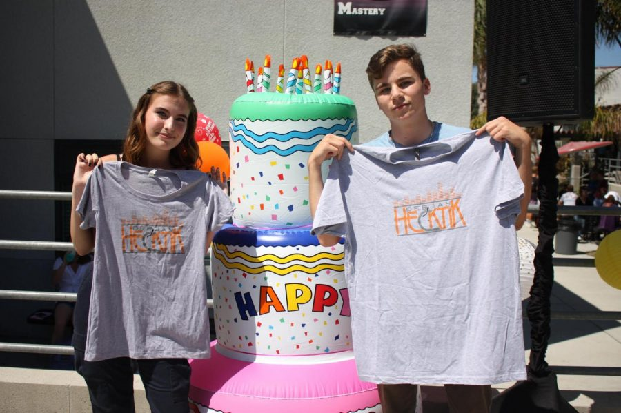 Ruby Beckendorf '21 and Noah Hilles '20 receive t-shirts after dancing on the stage.