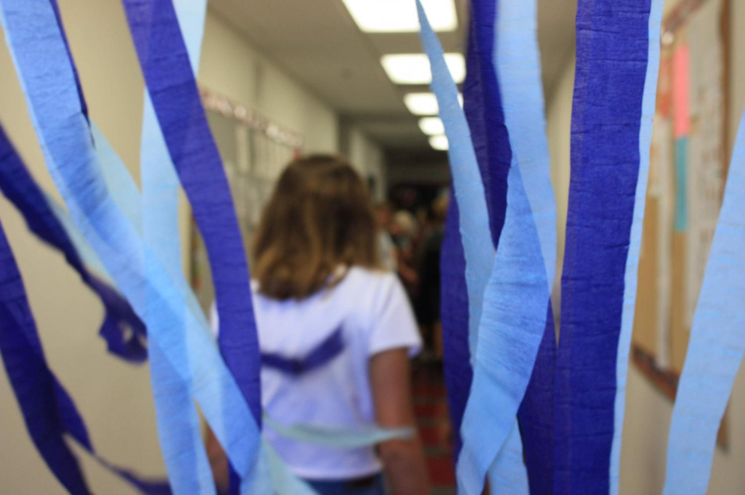 A freshman passes through streamers leading into the Black Box