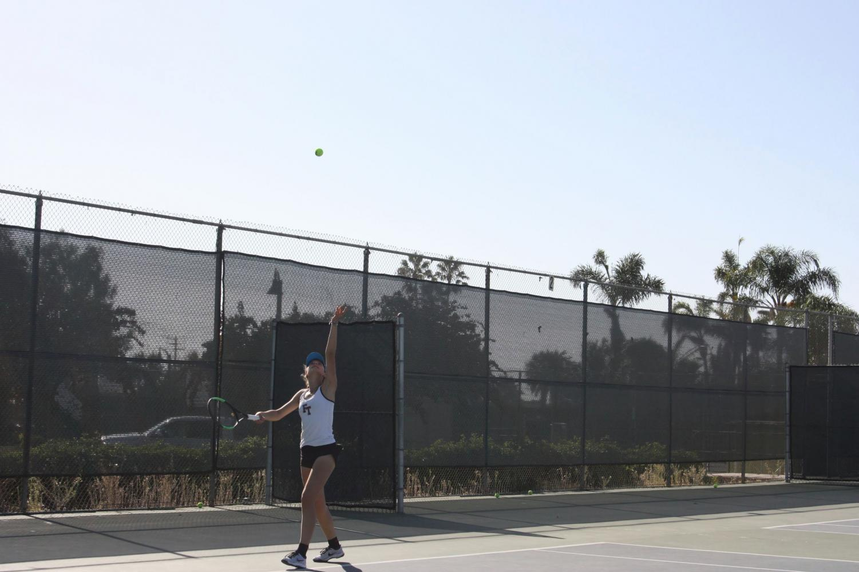 Noelle Hayward '21 serves the ball