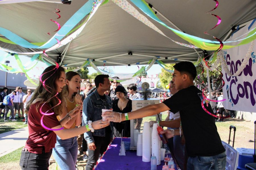 Students recieve snow cones along with many other food options from ASB