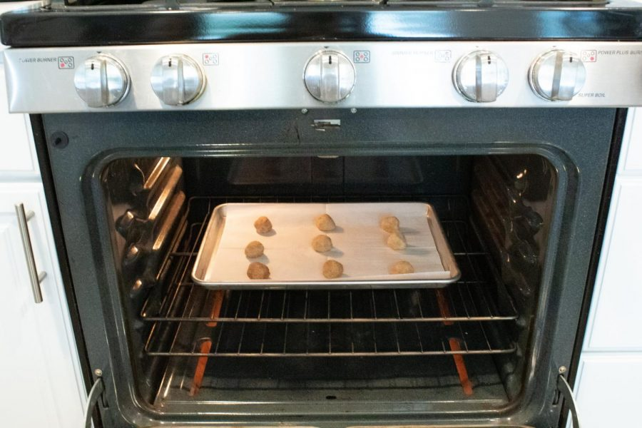 Place dough balls two inches apart on the pan and put into the oven at 350 degrees for nine minutes, then cool for 10 minutes