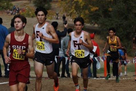 From the 2018 state finals, Jason Messner and Joshua Villasenor work up the hill at the two-mile marker.