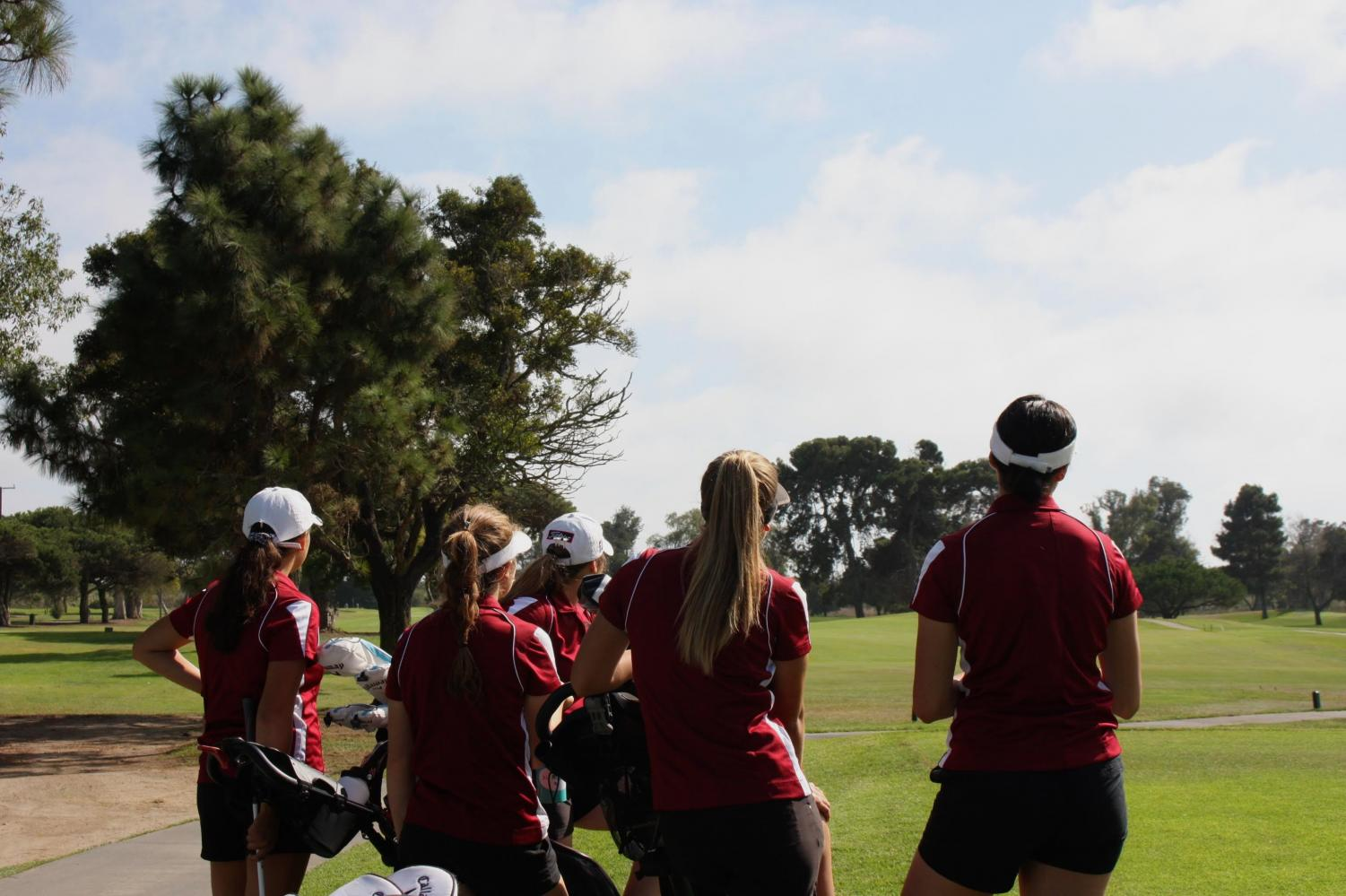 The girls golf team watches the sky set on one of their final matches together